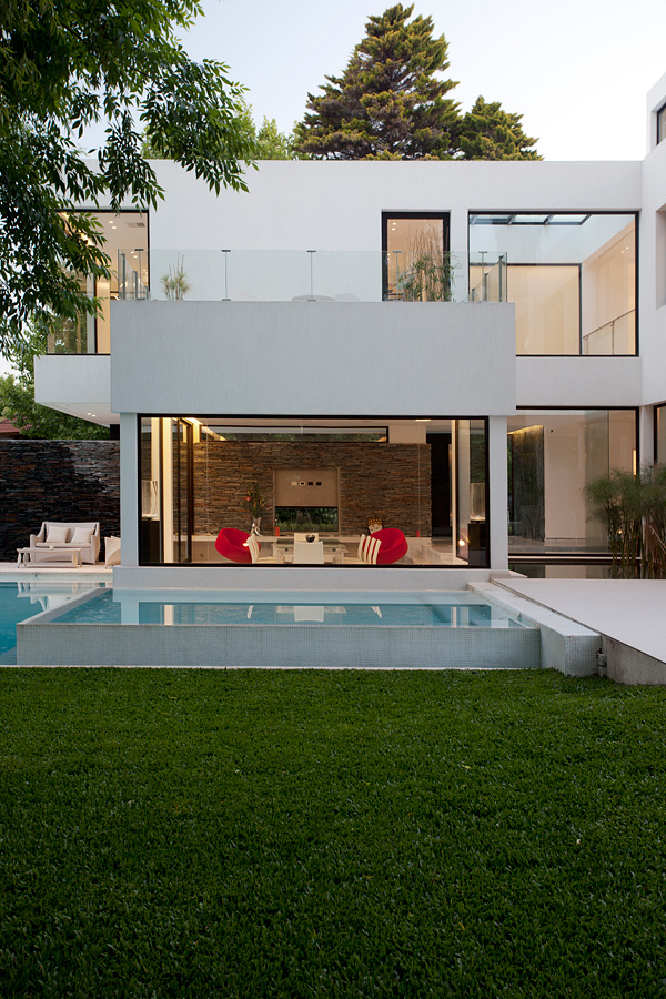 Andres Remy Arquitectos designed the Carrara House in Pilar, Argentina.