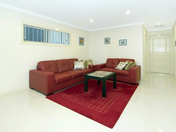 comfortable interior with red sofa furniture set