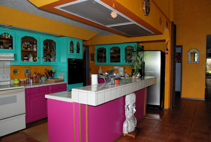 colorful kitchen design with combination of Pink, orange and green