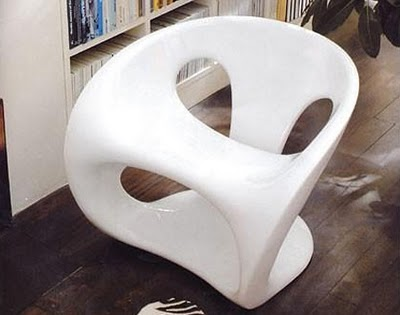 Futuristic bio-energetic chair handmade from lacquered fiberglass