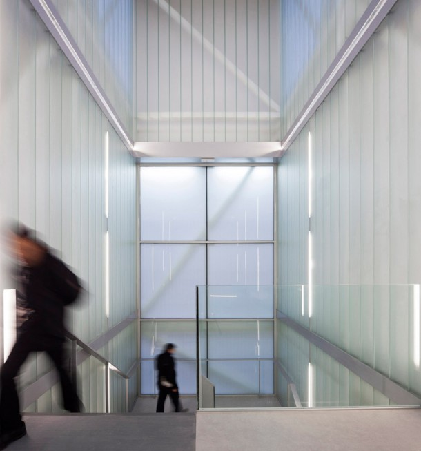 stair within a translucent glass atrium